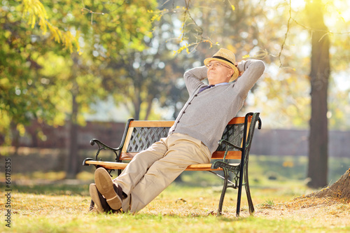 Senior man relaxing in park on a sunny day