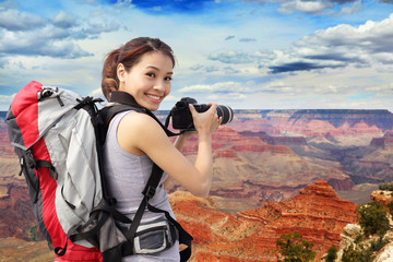 woman mountain hiker taking pictures
