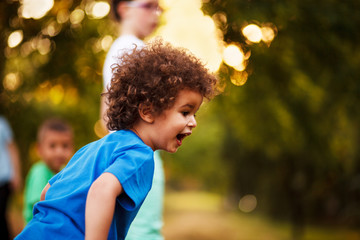 Cute mixed race boy, in park