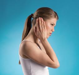 Tinnitus. Sick female having ear pain.