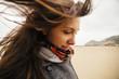 young woman on windy beach, Bosa, Sardinia, Italy