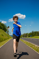Boy running, jumping outdoor