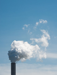 White smoke from an industrial chimney