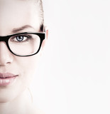 Close-up of lovely woman in optical eyeglasses