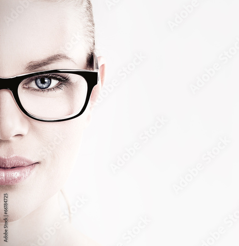 Close-up of lovely woman in optical eyeglasses - 66184725
