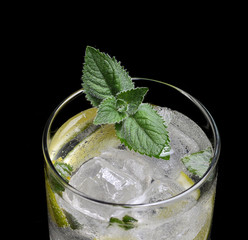 mojito with mint and ice on a black background