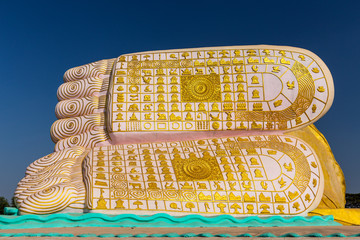 The Feet of Buddha on a reclining Buddha statue in Bago