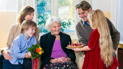Grandma gets a birthday cake.