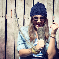 beautiful girl with glasses singing outdoor, young singer, toned