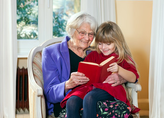 Grandmother and Young Girl Reading.