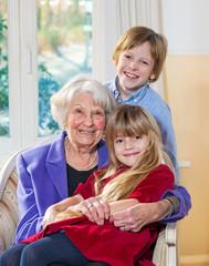Portrait of a grandmother with her grandchildren.