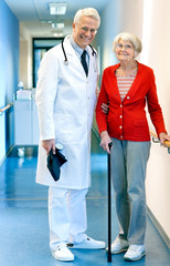Doctor with an elderly woman patient in hospital.