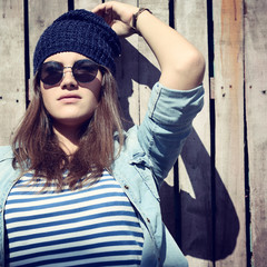 portrait of beautiful cool girl in hat and sunglasses
