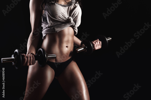 Fitness woman in hard training - 66189548