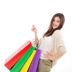 beautiful happy girl shopaholic with colored shopping bags, over