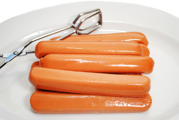 Raw Hot Dogs on a Plate Ready to be Cooked