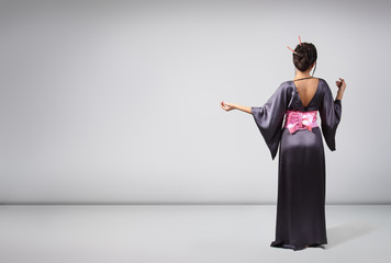 Young beautiful asian woman in kimono, full length portrait, stu