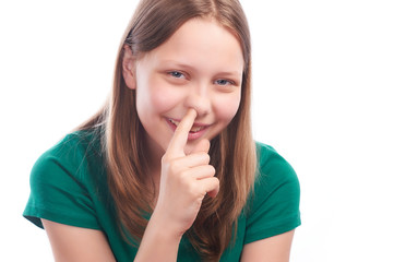 Teen girl picking her nose