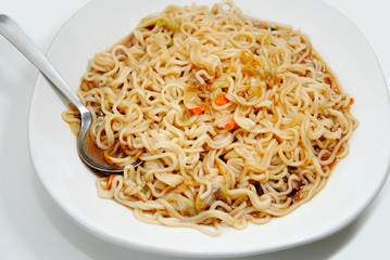 Eating Japanese Noodle Soup with Vegetables with a Spoon