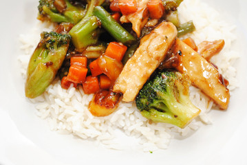 Stir Fried Chicken and Vegetables Served Over White Rice