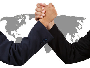 Businessman handshake with world map isolated on white backgroun