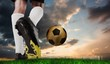 Composite image of football boot kicking gold ball