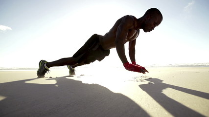 Push ups at the beach