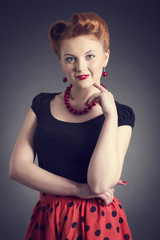 Portrait of a beautiful young woman in a pin-up.