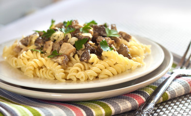 Spiral pasta with morel mushrooms