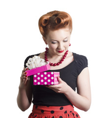Beautiful woman with gift box in hands in a retro style.