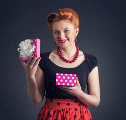 Portrait of a young woman with a gift box pin-up.