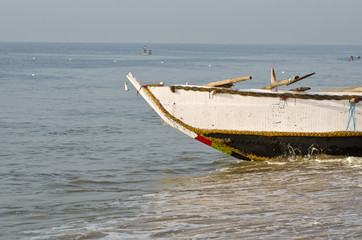 fishing boat on Bengal sea beach, India