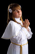 Brunette young girl praying for first communion