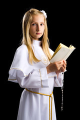 First communion for cute blonde girl