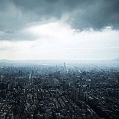 Aerial view of Taipei, Taiwan under dark clouds.