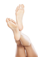 female bare feet on white background