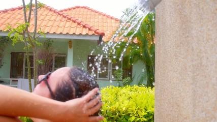 Girl Enjoying a Shower in Sunny Day near Villa