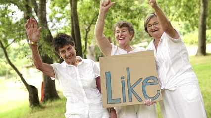 "Senior women with a ""like"" sign"