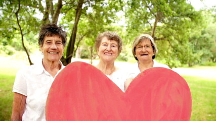 Grandmothers holding heart sign