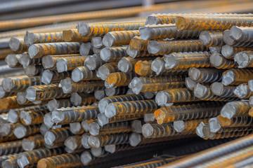 Stack of steel reinforcement rods background 2
