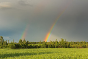 Double rainbow in a sky after storm