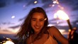 Smiling young woman with sparkler at sunset in slow motion