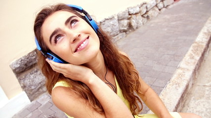 Young woman listening to music in slow motion