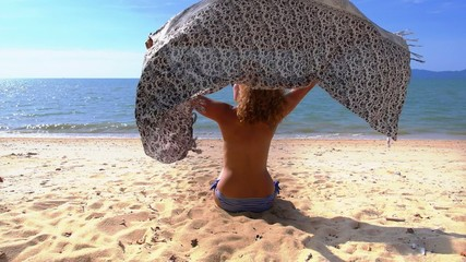 Nude Woman Relaxing on the Beach with Pareo. Slow Motion.