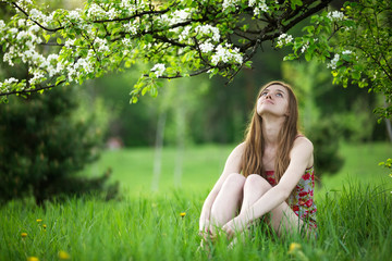 Young woman enjoying spring blossom