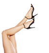canvas print picture - pretty female legs in elegant sandals with high heels