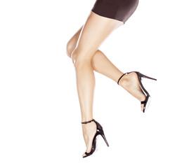 pretty female legs in elegant sandals with high heels