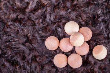 Karakul fur texture and cedar