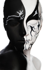Portrait of woman with black and white face art