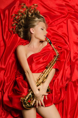 Woman in red dress playing the saxophone